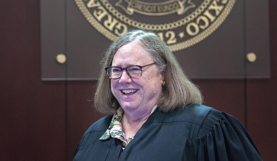 This Aug. 11, 2017 photo shows District Judge Sarah Singleton smiling after a ruling in Santa Fe, N.M. Singleton, a retired district court judge who presided over multiple landmark cases in New Mexico, has died at 70, officials said Friday, July 5, 2019. (Eddie Moore/The Albuquerque Journal via AP)