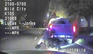 FILE--In this file image made from a Nov. 1, 2016 dashcam video released by Cedar Rapids Police Department, unarmed black motorist Jerime Mitchell struggles with officer Lucas Jones before the driver is shot and paralyzed. The incident also threatened the life of the city's deputy police chief when the injured man's speeding truck smashed into his patrol SUV, newly released records show. The City of Cedar Rapids this week released police reports detailing its response to the incident. (Cedar Rapids Police Department via AP File)