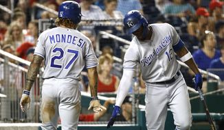 Kansas City Royals' Jorge Soler, right, greets teammate Adalberto Mondesi after Mondesi scored on Hunter Dozier's single in the fifth inning of a baseball game against the Washington Nationals, Friday, July 5, 2019, in Washington. (AP Photo/Patrick Semansky)