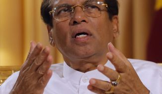 FILE - In this Tuesday, May 7, 2019 file photo, Sri Lankan President Maithripala Sirisena speaks during an interview with the Associated Press at his residence in Colombo, Sri Lanka. Sri Lanka's Supreme Court issued a temporary injunction until Oct. 30 against the execution of four people convicted of drug-related offences on Friday, July 5, a week after the country's president announced that he would end the island nation's 43-year moratorium on death penalty. (AP Photo/Eranga Jayawardena, File)