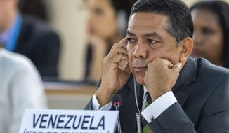 William Castillo, Vice Minister of Foreign Affairs of Venezuela, talk about the situation of human rights in Venezuela, during the 41th session of the Human Rights Council, at the European headquarters of the United Nations in Geneva, Switzerland, Friday, July 05, 2019. (Martial Trezzini/Keystone via AP)