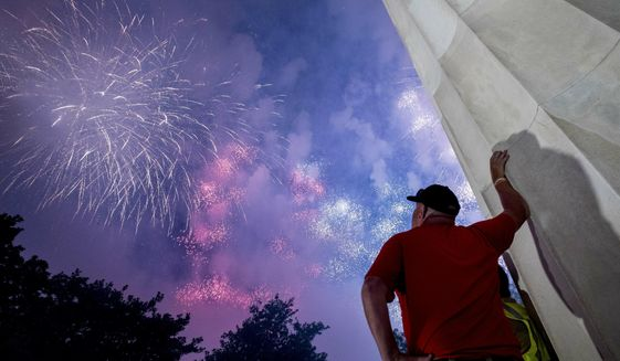 Fireworks seen from the Lincoln Memorial explode over the Potomac River for Independence Day, Thursday, July 4, 2019, in Washington. (AP Photo/Andrew Harnik) ** FILE **