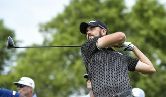 Troy Merritt tees off on the 18th hole during the third round of the 3M Open golf tournament in Blaine, Minn., Saturday, July 6, 2019. (Aaron Lavinsky/Star Tribune via AP)