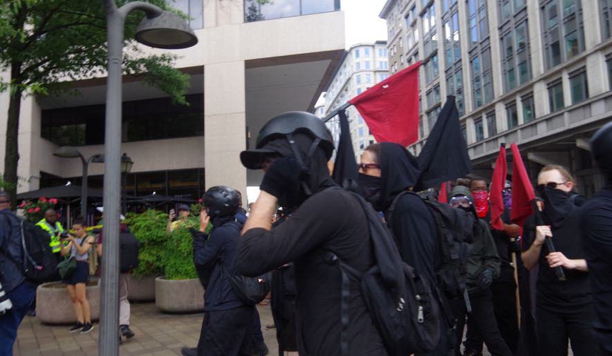 In this file photo, protesters clash with police as Antifa tries to rush the police line into the Demand Free Speech Rally in downtown Washington, D.C., on July 6, 2019. (Moss Brennan/The Washington Times) ** FILE **