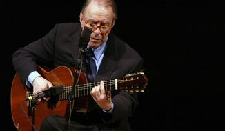 FILE - In this June 18, 2004 file photo, Brazilian composer Joao Gilberto performs at Carnegie Hall, in New York. The Brazilian singer and composer, who is considered one of the fathers of the Bossa Nova genre, has died.His death was confirmed by his children on Saturday, July 6, 2019. Gilberto was 88 years old. (AP Photo/Mary Altaffer, File)