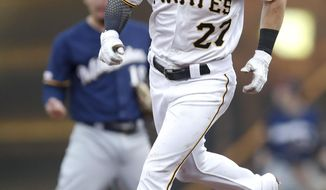 Pittsburgh Pirates' Kevin Newman rounds second in front of Milwaukee Brewers second baseman Keston Hiura after hitting a solo home run in the fourth inning of a baseball game Saturday, July 6, 2019, in Pittsburgh. (AP Photo/Keith Srakocic)