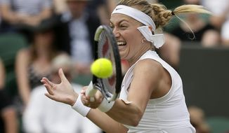 Czech Republic's Petra Kvitova returns to Polands's Magda Linette in a Women's singles match during day six of the Wimbledon Tennis Championships in London, Saturday, July 6, 2019. (AP Photo/Tim Ireland)