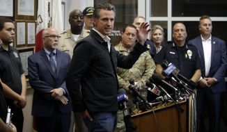 California Gov. Gavin Newsom, at podium, makes a statement after touring the town Saturday, July 6, 2019, in Ridgecrest, Calif. Crews in Southern California assessed damage to cracked and burned buildings, broken roads, leaking water and gas lines and other infrastructure Saturday after the largest earthquake the region has seen in nearly 20 years jolted an area from Sacramento to Las Vegas to Mexico. (AP Photo/Marcio Jose Sanchez)
