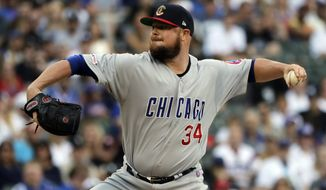Chicago Cubs starting pitcher Jon Lester throws against the Chicago White Sox during the first inning of a baseball game in Chicago, Saturday, July 6, 2019. (AP Photo/Nam Y. Huh)