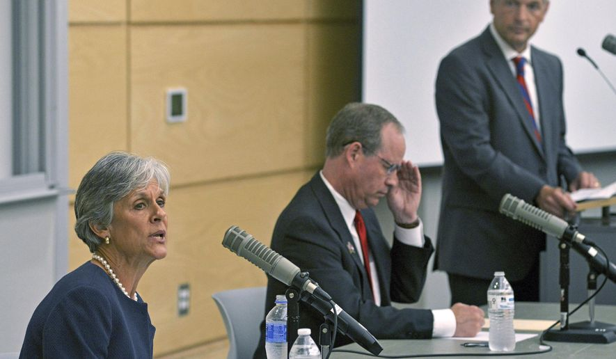 In this June 3, 2017 photo, Dr. Joan Perry of Kinston, left, answers a question during a debate with and state Rep. Greg Murphy, a Greenville physician, in Greenville, N.C. The two Republicans are running in a special primary election to be held July 9 for North Carolina's 3rd Congressional seat. (Deborah Griffin/The Daily Reflector via AP)