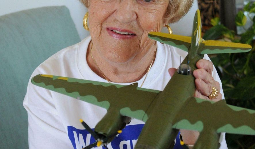 """File-Kay Catherine Eckley Bentley displays a model of a B-26 Marauder in her home in Ormond Beach in 2014. Bentley, who has since died, worked as a real """"Rosie the Riveter"""" in Baltimore before owning, then getting involved in legal battles over a 1930 Cord L-29 classic convertible. (Daytona Beach News-Journal, file)"""