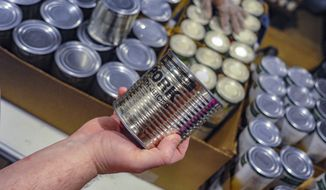 In this May 15, 2019 photo, canned meat from Lakeside Foods in Owatonna, Minn., was purchased by the USDA to offset losses from the ongoing trade wars with China, Mexico and other countries.(Photo by Chris Walljasper/Midwest Center for Investigative Reporting via AP)