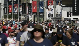 FILE - In this June 29, 2019, file photo, fans arrive before a baseball game between the Boston Red Sox and the New York Yankees, in London. Major League Baseball is trying to muscle in on a crowded marketplace in Britain dominated by soccer but also filled with cricket, rugby _ and this month Wimbledon. (AP Photo/Tim Ireland, File)