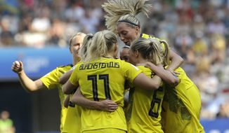 Sweden players celebrate after Sweden's Kosovare Asllani scored her side's opening goal during the Women's World Cup third place soccer match between England and Sweden at Stade de Nice, in Nice, France, Saturday, July 6, 2019. (AP Photo/Claude Paris)