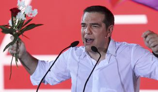 Greek Prime Minister and Syriza party leader Alexis Tsipras addresses supporters during his main election campaign rally in Athens, Friday, July 5, 2019. Greeks head to the polls in early general elections on Sunday, July 7. (AP Photo/Petros Giannakouris)