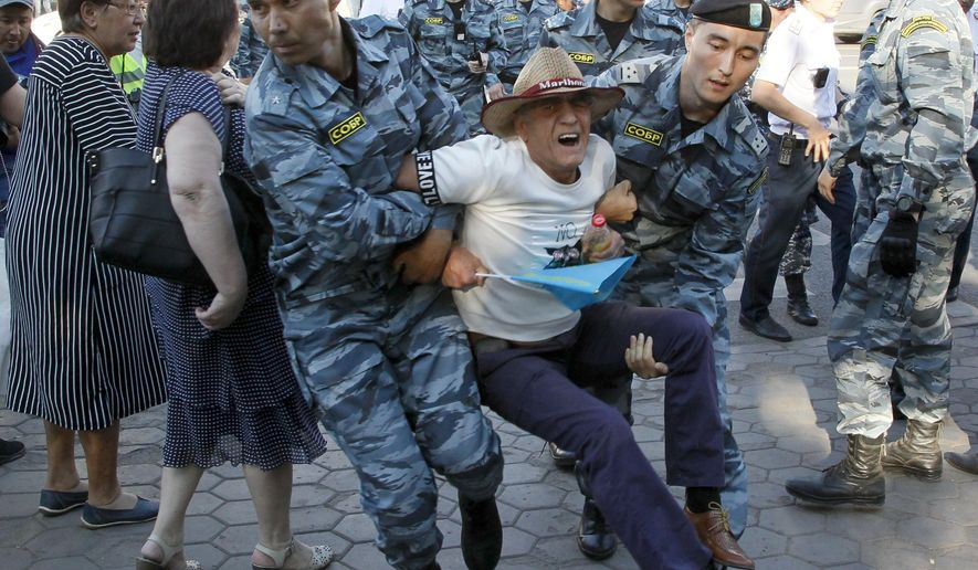 Kazakhstan's police officers detain a protester during a rally in Nur-Sultan, Kazakhstan, Saturday, July 6, 2019. Local media say more than one hundred people have been detained at anti-government rallies in Kazakhstan. (AP Photo)