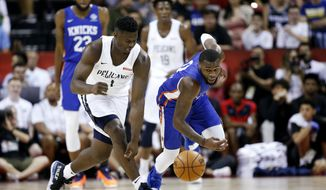 New Orleans Pelicans' Zion Williamson, left, and New York Knicks' Kadeem Allen chase the ball during an NBA summer league basketball game Friday, July 5, 2019, in Las Vegas. (AP Photo/Steve Marcus) ** FILE **
