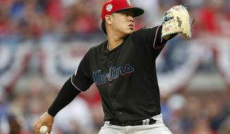 Miami Marlins starting pitcher Jordan Yamamoto works in the first inning of the team's baseball game against the Atlanta Braves on Friday, July 5, 2019, in Atlanta. (AP Photo/John Bazemore)
