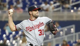 Washington Nationals' Max Scherzer delivers a pitch during the sixth inning of the team's baseball game against the Miami Marlins, Tuesday, June 25, 2019, in Miami. Scherzer struck out 10 in eight innings and won his fifth straight start as the Nationals won 6-1. (AP Photo/Wilfredo Lee) ** FILE **
