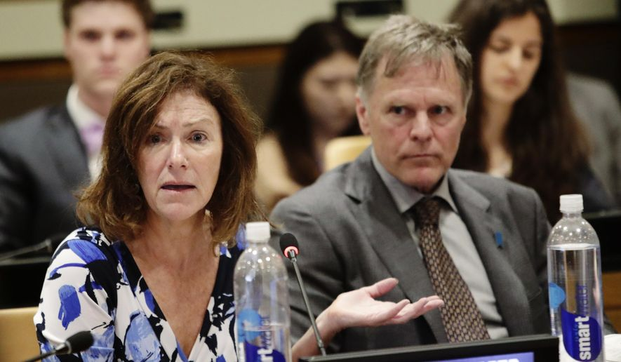 In this May 3, 2018 file photo, Fred Warmbier, right, listens as his wife Cindy Warmbier, speaks of their son Otto Warmbier, an American who died in 2017 days after his release from captivity in North Korea, during a meeting at the United Nations headquarters. (AP Photo/Frank Franklin II)