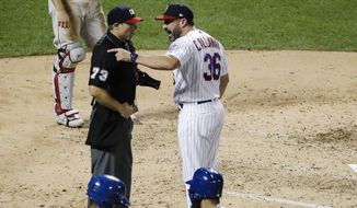 New York Mets manager Mickey Callaway, right, argues with home plate umpire Tripp Gibson after Callaway was ejected during the fifth inning the team's baseball game against the Philadelphia Phillies on Saturday, July 6, 2019, in New York. (AP Photo/Frank Franklin II)