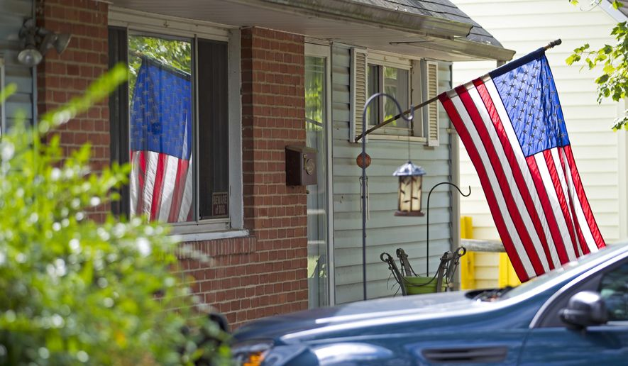 In this Oct. 5, 2016 file photo, the house of Harold Thomas Martin III is seeing in Glen Burnie, Md.  A high-profile raid at the home of an NSA contractor seemed to be linked to the devastating leak of U.S. government hacking tools. Three years later, the case is being resolved but whoever was behind the leak of the hacking tools remains a mystery with significant national security implications. (AP Photo/Jose Luis Magana)