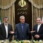 "Iranian Deputy Foreign Minister Abbas Araghchi (right) says Iran considers the 2015 nuclear deal to be a ""valid document."" He's pictured here with atomic agency spokesman Behrouz Kamalvandi (left) and government spokesman Ali Rabiei. (ASSOCIATED PRESS)"
