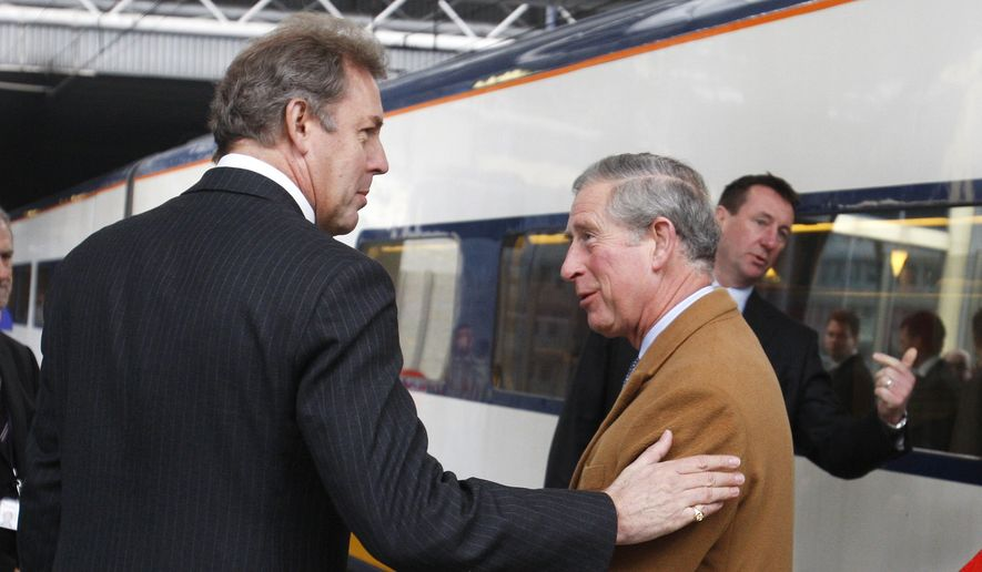 Britain's Ambassador to the EU Kim Darroch, left, welcomes Britain's Prince Charles upon his arrival at Brussels Midi train station in Brussels, Wednesday, Feb. 13, 2008. Prince Charles is on a two-day visit to European Union institutions. (AP Photo/Thierry Roge, Pool)