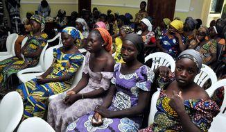 Chibok school girls recently freed from Boko Haram captivity are seen in Abuja, Nigeria, Sunday, May 7, 2017. (AP Photo/ Olamikan Gbemiga) ** FILE **
