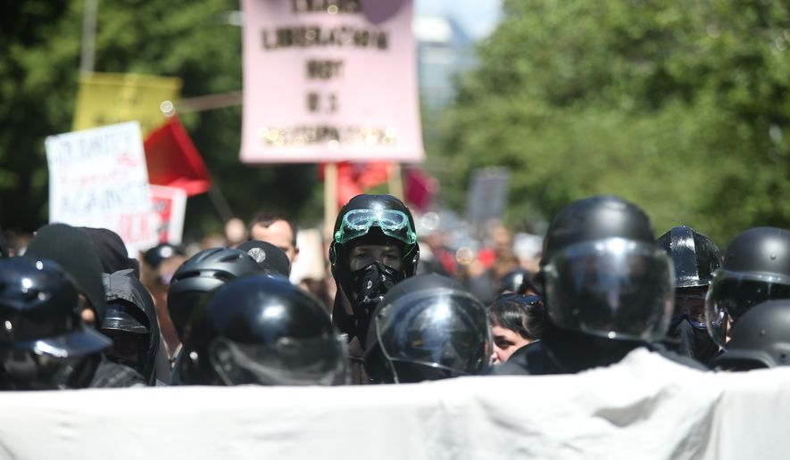 Multiple groups, including Rose City Antifa, the Proud Boys and conservative activist Haley Adams protest in downtown Portland, Ore., Saturday, June 29, 2019. (Dave Killen/The Oregonian via AP)