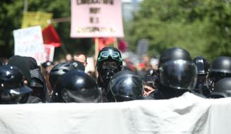 Multiple groups, including Rose City Antifa, the Proud Boys and conservative activist Haley Adams protest in downtown Portland, Ore., Saturday, June 29, 2019. (Dave Killen/The Oregonian via AP) ** FILE **