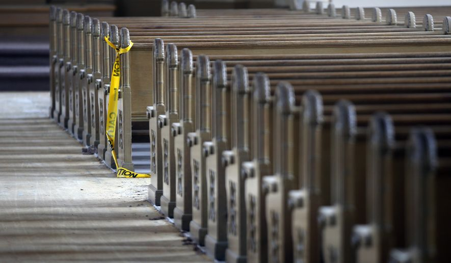 Caution tape hangs from a pew in the St. Andre's Catholic Church in Biddeford, Maine, Thursday, July 24, 2014. The church, which opened in 1900, has sat empty for four years. (AP Photo/Robert F. Bukaty) **FILE**