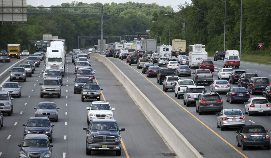 In this May 23, 2014 file photo, traffic moves on the Interstate 495, the Capital Beltway, in Hyattsville, Md., outside Washington. (AP Photo/Carolyn Kaster, File) **FILE**