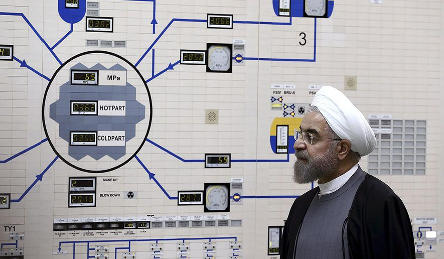 In this Jan. 13, 2015, file photo released by the Iranian President's Office, President Hassan Rouhani visits the Bushehr nuclear power plant just outside of Bushehr, Iran. Iran announced Sunday, July 7, 2019 it will raise its enrichment of uranium, breaking another limit of its faltering 2015 nuclear deal with world powers and further heightening tensions between Tehran and the U.S. (AP Photo/Iranian Presidency Office, Mohammad Berno, File)
