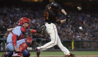 San Francisco Giants' Austin Slater, right, hits a grand slam in front of St. Louis Cardinals catcher Matt Wieters during the fourth inning of a baseball game in San Francisco, Saturday, July 6, 2019. (AP Photo/Jeff Chiu)