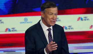 In this June 27, 2019, file photo, Democratic presidential candidate and former Colorado Gov. John Hickenlooper speaks during the Democratic primary debate hosted by NBC News at the Adrienne Arsht Center for the Performing Arts, in Miami. (AP Photo/Wilfredo Lee, File)