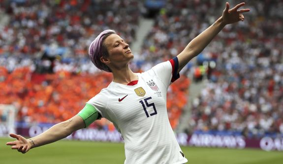 United States' Megan Rapinoe celebrates after scoring the opening goal from the penalty spot during the Women's World Cup final soccer match between the U.S. and The Netherlands at the Stade de Lyon in Decines, outside Lyon, France, Sunday, July 7, 2019. (AP Photo/Francisco Seco)