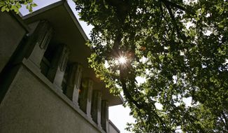FILE - This Sept. 27, 2005, file photo, shows an an exterior view of Frank Lloyd Wright's Unity Temple with its incredibly bold cubic design in Oak Park, Ill. Eight buildings, including the Unity Temple, designed by the architect during the first half of the 20th century, where honored as World Heritage sites by United Nations Educational, Scientific and Cultural Organization, or UNESCO, on Sunday, July 7, 2019.  (AP Photo/Charles Rex Arbogast, File)