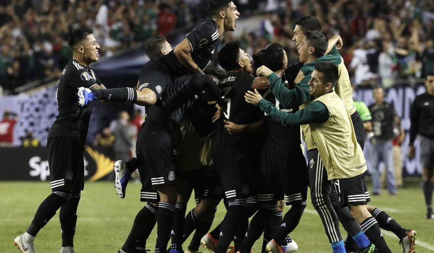 Mexico midfielder Jonathan Dos Santos (6) celebrates with teammates after scoring his first goal against the United States during the second half of the CONCACAF Gold Cup final soccer match in Chicago, Sunday, July 7, 2019. (AP Photo/Nam Y. Huh) ** FILE **