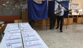 An elderly man casts his ballot at a polling station in Athens, on Sunday, July 7, 2019. Greeks are voting in the first parliamentary election since their country emerged from three successive international bailouts but is still struggling to emerge from a crippling nearly decade-long financial crisis. (AP Photo/Yorgos Karahalis)
