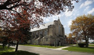 In this May 6, 2019, photo, the exterior of a Catholic parish in Detroit, Mich., is seen. (AP Photo/Paul Sancya)