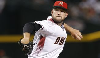 Arizona Diamondbacks pitcher Alex Young throws against the Colorado Rockies in the first inning of a baseball game, Sunday, July 7, 2019, in Phoenix. (AP Photo/Rick Scuteri)
