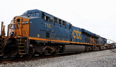 "CSX Transportation is one of seven Class 1 freight train firms with annual operating revenues of $450 million or more. Despite a report of longer trains creating lengthy railroad crossings, CSX states that longer trains are a ""tried and proven way to increase efficiency."" (ASSOCIATED PRESS)"