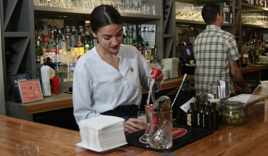 Rep. Alexandria Ocasio-Cortez, D-N.Y., mixes margaritas while tending bar at a restaurant in the Queens borough of New York, Friday, May 31, 2019. She was back in her New York district tending bar as part of her push to raise the federal minimum wage, especially for workers who now depend on tips. (AP Photo/Steven R. Groves)
