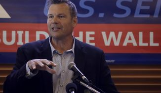 Former Kansas Secretary of State Kris Kobach addresses the crowd as he announces his candidacy for the Republican nomination for the U.S. Senate Monday, July 8, 2019, in Leavenworth, Kan. (AP Photo/Charlie Riedel)