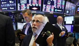 Trader Peter Tuchman works on the floor of the New York Stock Exchange, Monday, July 8, 2019. (AP Photo/Richard Drew) ** FILE **