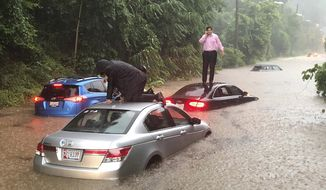 Motorists are stranded on a flooded section of Canal Road in Washington during a heavy rainstorm, Monday, July 8, 2019. (Dave Dildine/WTOP via AP)