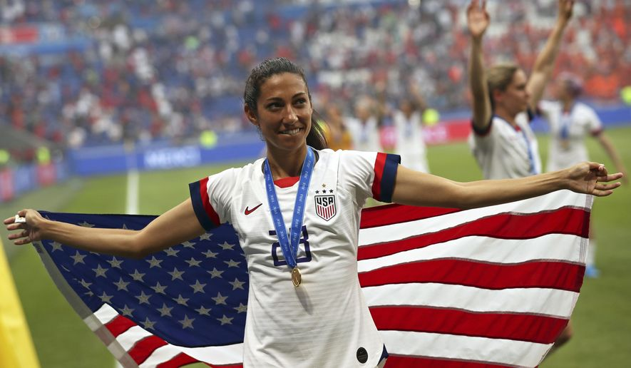 United States' Christen Press celebrates at the end of the Women's World Cup final soccer match between US and The Netherlands at the Stade de Lyon in Decines, outside Lyon, France, Sunday, July 7, 2019. The US defeated the Netherlands 2-0. (AP Photo/Francisco Seco) ** FILE **