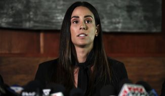 """FILE - In this April 23, 2019, file photo, former sports reporter Kelli Tennant speaks during a news conference in Los Angeles. Sacramento Kings coach Luke Walton denies sexual assault allegations leveled against him in a lawsuit from a former sportscaster. Walton says in a court brief filed Wednesday, July 3, 2019, that Kelli Tennant's accusations of sexual battery in 2014 are """"factually baseless"""" and designed to attract media attention. (AP Photo/Jae C. Hong, File)"""