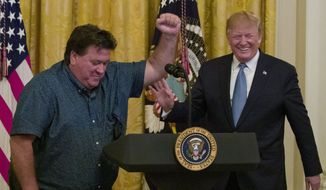 Bruce Hrobak, owner of Billy Bones Bait & Tackle in Port St. Lucie, Fla., speaks as President Donald Trump listens during an event about the environment in the East Room of the White House, Monday, July 8, 2019, in Washington. (AP Photo/Alex Brandon)